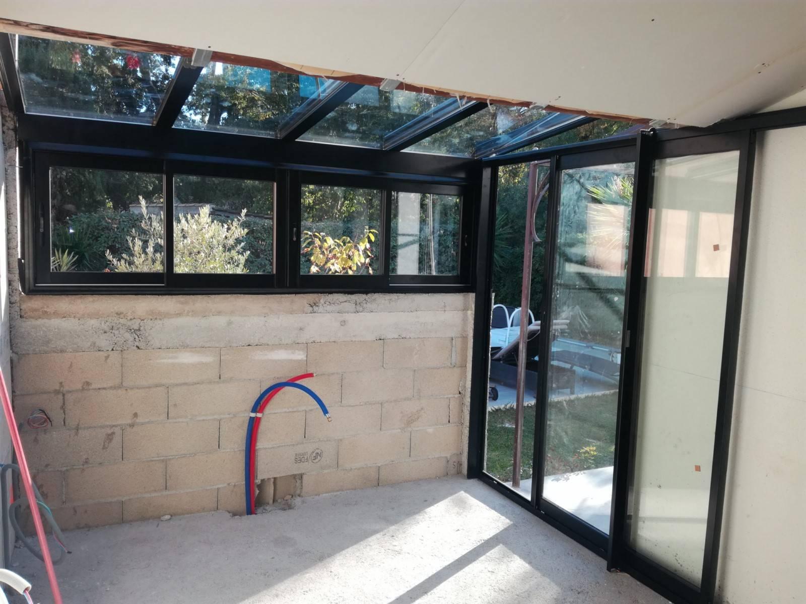 Veranda Metal Et Verre installation d'une véranda avec toiture en verre